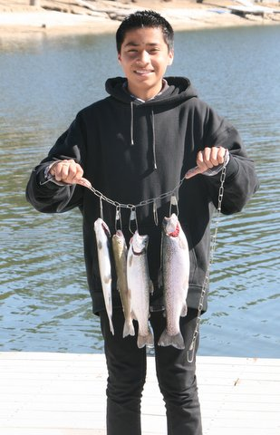 Young Boy with Bass Lake Catch