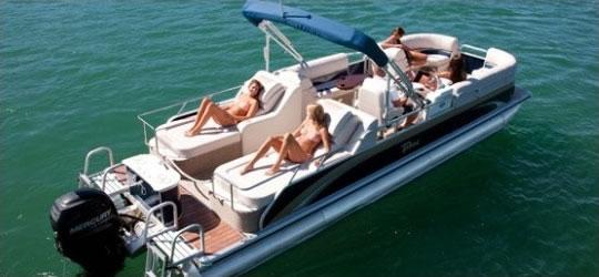 Elite Patio Boat with Rearward Facing Seats with People having fun Bass Lake Boat Rentals