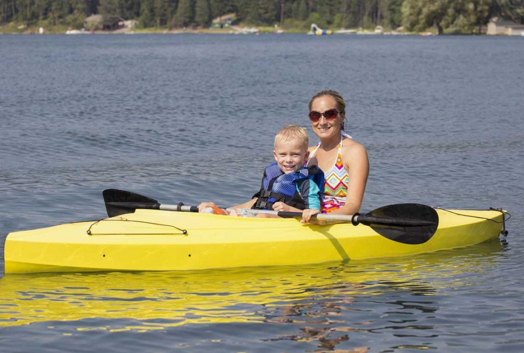 Mom and child kayaking on lake. Bass Lake Boat Rentals