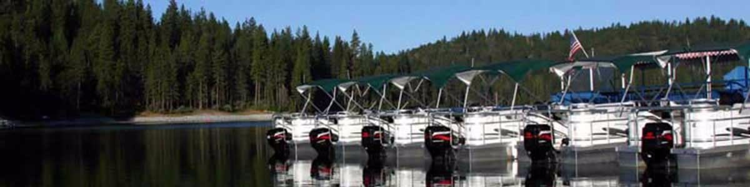 2015-parked-patio-boats-bass-lake-marina-slider