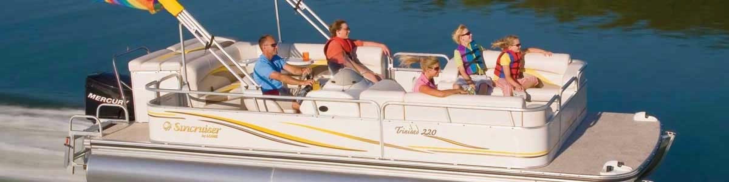 2015-sundowner-patio-boat-speeding-along-slider